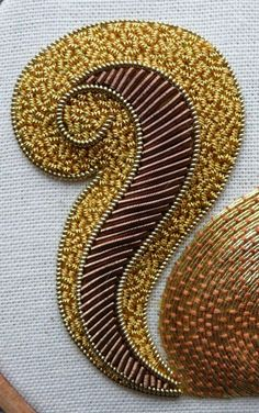 Work a metal thread embroidery Red Squirrel, in gold and copper/brown threads. You will learn the fundamental skills which encompass metal thread work.