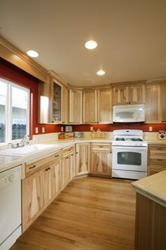 Hickory cabinets white appliances red wallsworks well with a dark