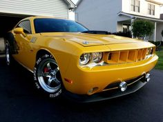 """The very popular Camrao A favorite for car collectors. The Muscle Car History Back in the and the American car manufacturers diversified their automobile lines with high performance vehicles which came to be known as """"Muscle Cars. Modern Muscle Cars, American Muscle Cars, Carros Oldies, 2012 Dodge Challenger, Challenger Hellcat, Gp Moto, Plymouth Muscle Cars, Yellow Car, Sweet Cars"""