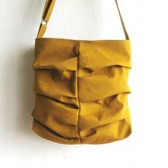 Horizontal pleated purse.