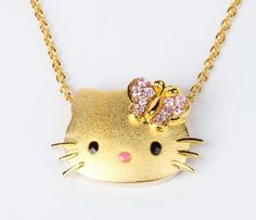 Sanrio Hello Kitty Simmons Jewelry gold-plated sterling silver face pendant with a pink crystal butterfly bow on a golden chain