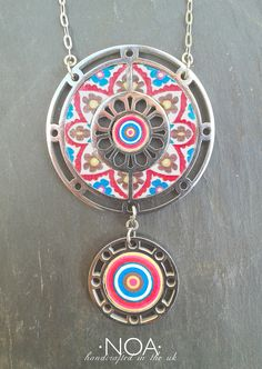 NOA Jewellery stainless steel & decorated walnut two circles in red blue and yelow. www.noajewellery.com