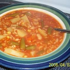 Vegetable Soup  In a large stock pot, combine broth, tomato juice, water, potatoes, carrots, celery, undrained chopped tomatoes, green beans, and corn. Season with salt, pepper and Creole seasoning. Bring to a boil and simmer for 30 minutes or until all vegetables are tender.