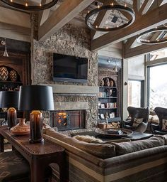 A roaring fire and a winter landscape for your view - what's not to love... This article does not share a good exterior picture of this mountain retreat - would love to see the building site. Sumptuous Montana retreat featuring cozy rustic-modern