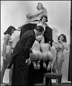 Salvador Dali working on his famous composition In Voluptas Mors photographed by Philippe Halsman.