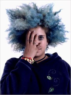 KIMYA DAWSON This picture of her is the best. I am obsessed with her hair here. It is like a poetic force of nature in the form of a magic cloud sprouting from the well of her imagination. She looks like a goddess who could make it rain or throw lighting from her fingers....and she makes punk folk music. That *is* magic I'm pretty sure.