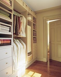 Martha Stewart closet from Home Depot.  I love the idea of adding a base underneath - it really adds to the look!