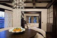 Dining room...dark wood, coffer ceiling... a foursquare home