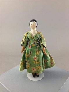"5 1/2"" TYNIETOY PEG WOODEN DOLLHOUSE LADY. PAINTED HAIR AND FACIAL FEATURES, DRESSED IN GREEN 1930s STYLE FLORAL PRINT DRESS."