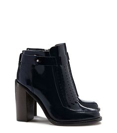 This bootie draws on the menswear-prep and British-countryside influences of the season. This reworking of a prim loafer is beautifully crafted in glossy blue calfskin. Set on a high block heel, it can bring tailored, tomboy polish to any look, day or evening.