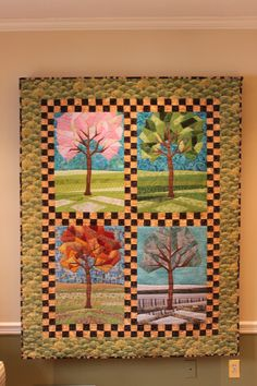 Four Seasons Quilt, designed and made by moi. I like the idea and trees on this quilt.  I could do without the checkered fabric.