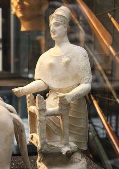 Athena terracotta figurine. Godess Athena mounting a four-horse chariot. Ca. 510-460 BC