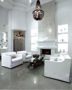 White walls contrast with polished grey concrete floors by Couture Concrete Systems.