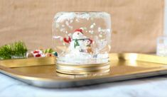 This DIY Mason Jar Snow Globe makes a beautiful homemade gift - customize it with favorite character figurines or travel souvenirs.