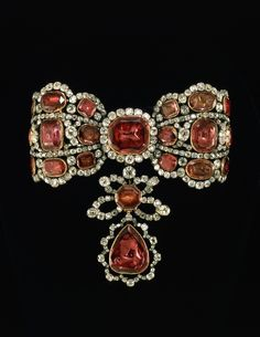 THE ROMANOVS JEWELRY COLLECTION ~~  the jewelry for hair, belong to Catherine II The Great, 1674. She and Elizabeth I, the daughter of Peter The Great, were fond of jewelry. Elizabeth preferred colorful flora theme, Catherine enjoyed bow-knots from diamonds and silver.