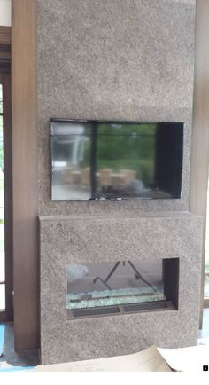 A recessed TV bracket on the stone wall. The TV is the same width as the fireplace for symmetry. Swivel Tv Stand, New Cinema, Big Screen Tv, Video Installation, Wall Mount Bracket, Entertainment Center, Tv Brackets, Stone, Cliff