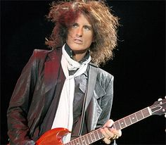 Joe Perry from Aerosmith. I once dreamt that I was going on a date with him to Six Flags. LOL I have a very interesting dream life!