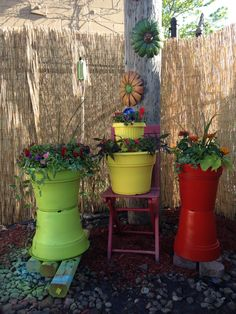 Up cycled old plastic planters .. Liquid nails and spray paint ... Love them !