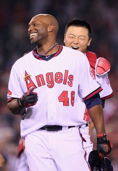eff4c92f9cb Torii Hunter #48 of the Los Angeles Angels of Anaheim is congratulated by  Hank Conger