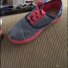 Toms 13.5 little boys tennis shoes. New Blue tennis shoes with red detail. Super cute! Never worn! 13.5. ****buy both toms for $50!!! That's a huge savings from $84+ originally for both! TOMS Shoes Sneakers