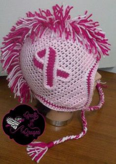 What a better way to show off your pride for breast cancer awareness, than to sport this head turning mohawk beanie featuring the ribbon on both