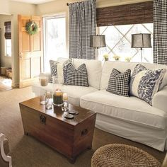 I have the cream walls, the chest, and brownish carpet.....I like this look, with the white and black.