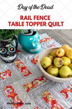 """Simple yet dramatic, this 24"""" Day of the Dead table topper quilt makes powerful use of the rail fence quilt pattern and seasonal fabrics. From NewQuilters.com. #railfencequiltpattern #railfencequiltideas #dayofthedeaddecorations #diadelosmuertosaltarideas #diadelosmuertosdecorations #rtabletopperpattern #tablerunnerpattern"""