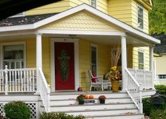 Love yellow houses with big porches