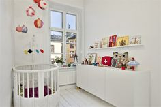 all white nursery with colorful accessories