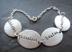 A great xmas present!  Personalized Hand Stamped Sterling Silver Name Bracelet. $37.00, via Etsy.