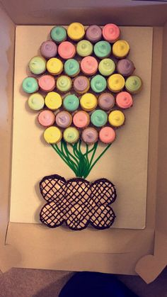 Hot Air Balloon Cupcake Cake. This is made with mini cupcakes as the balloon, green twizzlers and regular cupcakes as the basket.