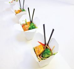 Sautéed Thai chicken over sesame noodles in micro takeout boxes, by Elegant Affairs Off-Premise Catering & Event Design in New York. Photo: Nadia Chaudhury/BizBash