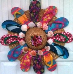 Enjoy making a straw hat flip-flop wreath! Use kinti, paint, and beads along with salvaged flip flops. Hat Crafts, Diy And Crafts, Arts And Crafts, Summer Deco, Beach Crafts, Summer Crafts, Holiday Wreaths, Holiday Crafts, Mesh Wreaths