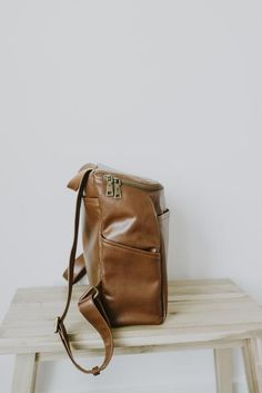 A minimalist faux leather backpack for the traveler 1c8cfe9dd61ea