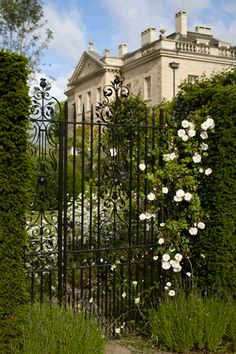 The garden front of Ferne Park viewed through a gate. Photo via QFT. The Devoted Classicist