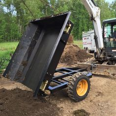 Dump trailer on mini excavator blade
