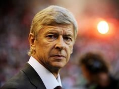 How many wins does Arsene Wenger hold over Chelsea?