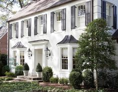 White houses with black shutters have always been one of my favorite things for as long as I can remember. The only thing I can tie it back...