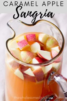 Caramel apple sangria is a cocktail with fun fall flavors. This fruity drink tastes like an adult caramel apple. Caramel Apple Sangria Recipe - Apple cider sangria with caramel vodka & white wine. This is the best easy Fall sangria recipe. Caramel Apple Sangria, Apple Cider Sangria, Caramel Apples, Cranberry Juice, Spiked Apple Cider, Fruity Drinks, Non Alcoholic Drinks, Yummy Drinks, Beverages