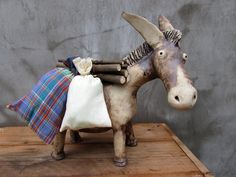 Ceramic donkey carrying a load of four sacks and by HomeyCreatures