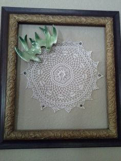 Old picture frame with crocheted doily.  Love my vintage birds