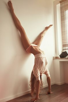 I don't really have a comment for this. It's just... wow. I wish I could: A) look like that B) do a handstand