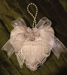 Shabby chic valentine's heart, made of vintage ivory fabric with lace and mini rhinestones brooch