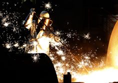 A worker controls a tapping of a blast furnace at Europe's largest steel factory of Germany's industrial conglomerate ThyssenKrupp AG in the western German city of Duisburg December 6, 2012. REUTERS/Ina Fassbender