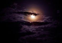 Dark clouds over moon