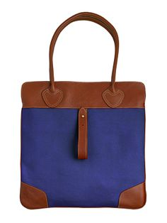 Zink Collection - Roll-Up- Egyptian Blue with Saddle Leather Trim, $295 (http://www.zinkcollection.com/roll-up-egyptian-blue-with-saddle-leather-trim/)