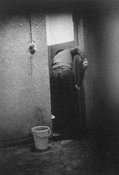 "<strong>Caption from LIFE.</strong> ""Doing chores, Eichmann mops bathroom floor in jail near Haifa where he has been held."""