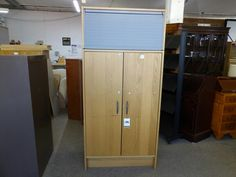 Office cupboard with roll top (repair needed to one shelf, can send more pictures on request), measurements are H-179cm W-84cm D-42.5cm ----------------- £65 (pc621)