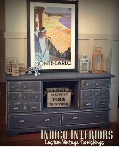 Indigo painted dresser with a single basket center.