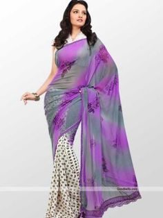 Get simple yet trendy look wearing this dual shade saree. Off white skirt portion with shaded pallu makes it truly designer and partywear dress. Floral prints with silver stones enhancing its beauty. It will look good for semi-formal and kitty parties. http://goodbells.com/saree/designer-pattern-off-white-and-grey-shade-saree.html